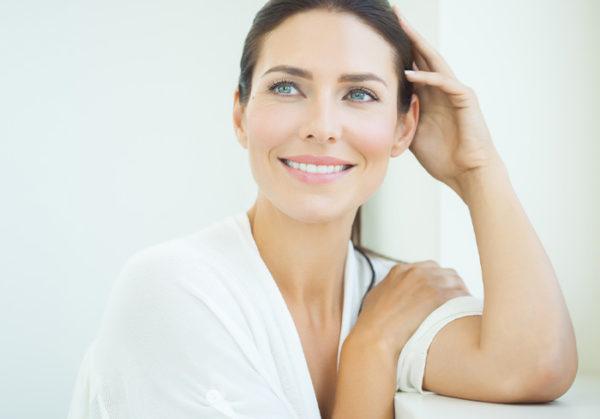 Beautiful woman with amazing skin smiling